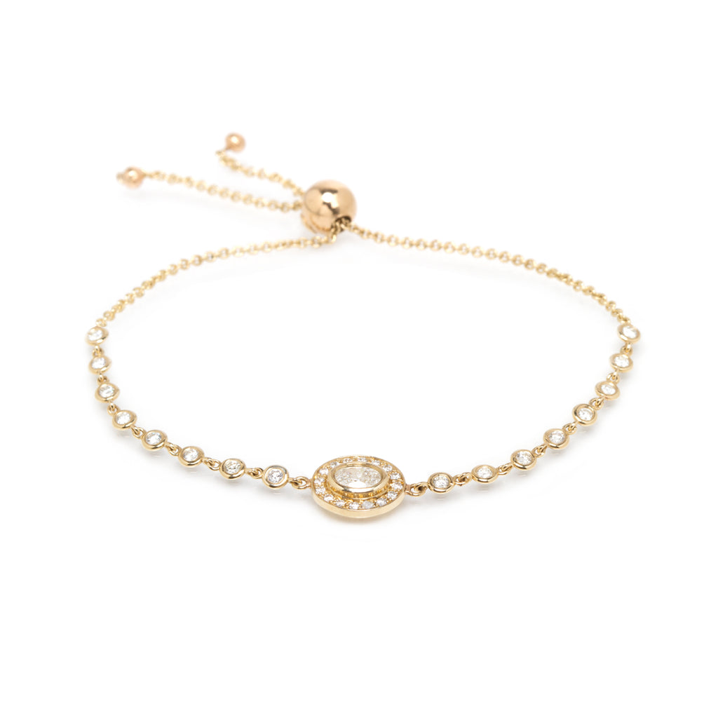 14k halo bolo tennis bracelet with oval diamond