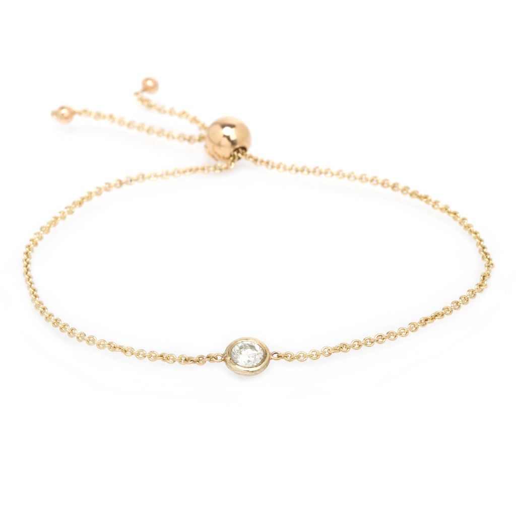 14k bolo bracelet with a single floating diamond
