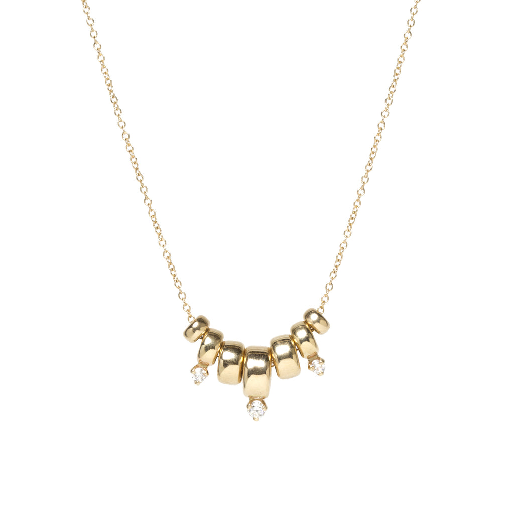 14k gold 7 graduated rondelle and prong diamond necklace