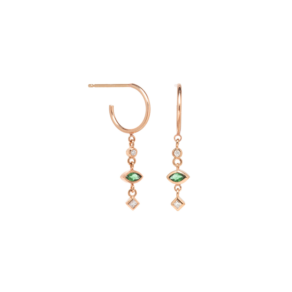 14k gold tiny huggie hoops with 2 mixed diamonds and a marquise emeralds dangling