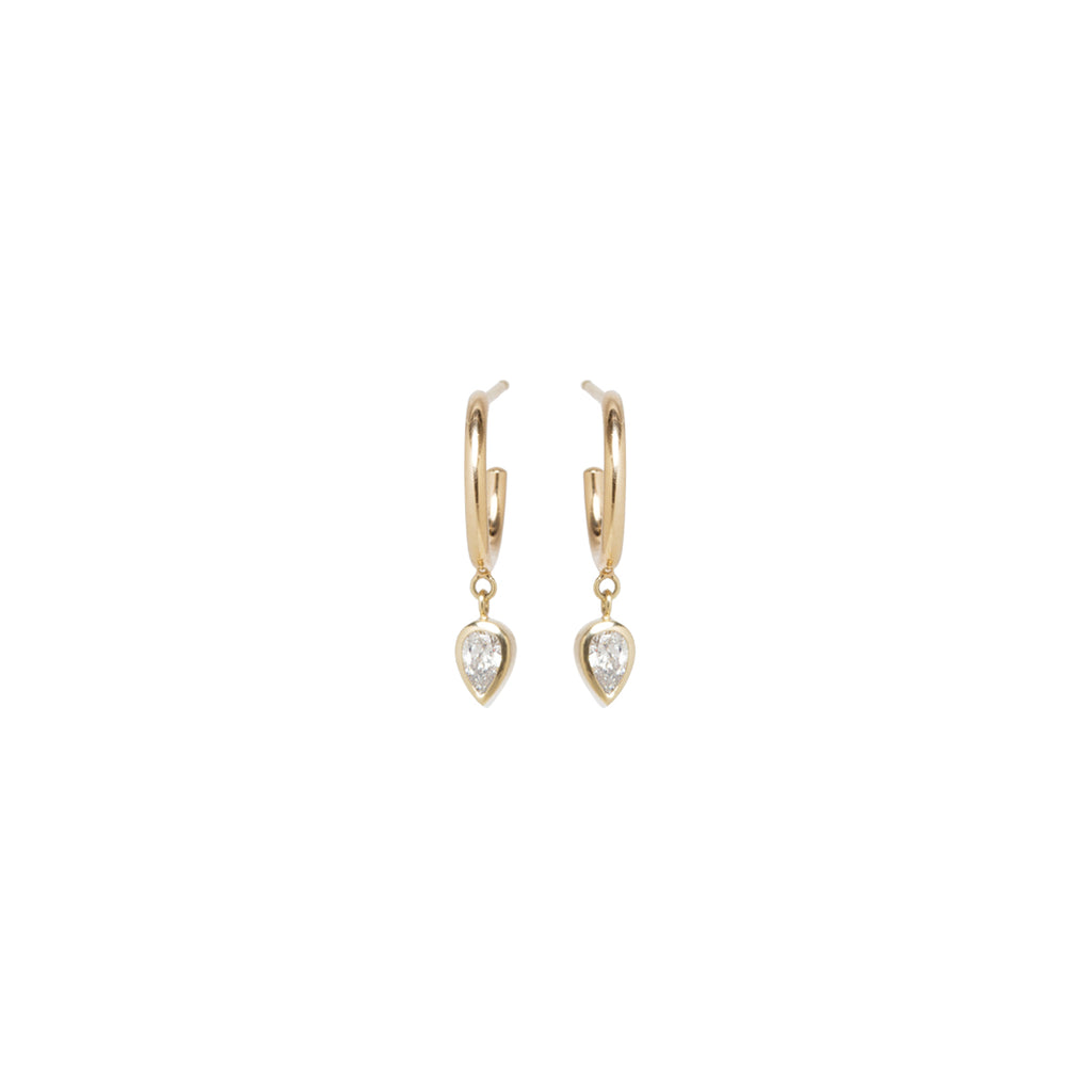 14k thick huggie hoops with dangling pear diamonds