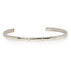 14k half round cuff with scattered diamonds