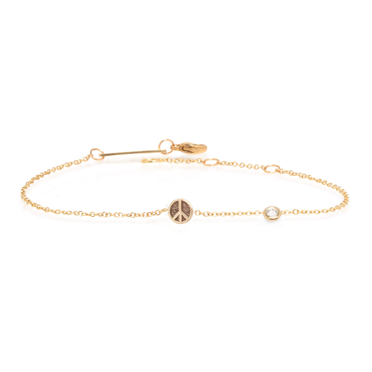 14k itty bitty peace sign bracelet with floating diamond