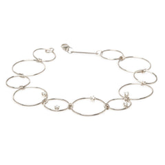 14k mixed circles and prong diamond bracelet