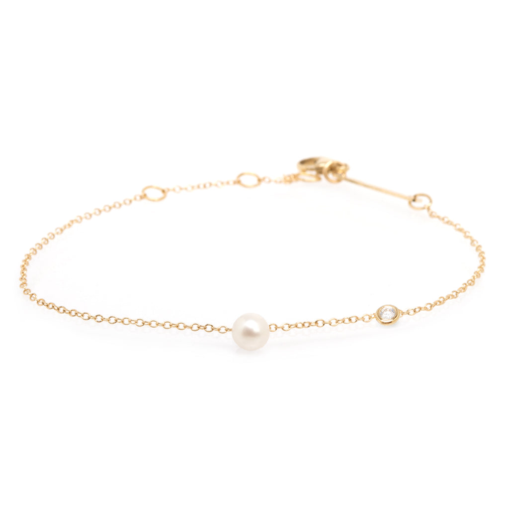 14k gold chain dangling pearl bracelet floating diamond in the chain