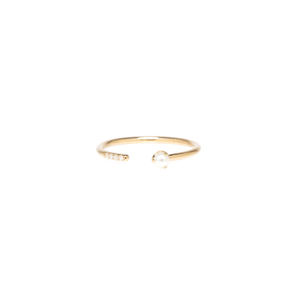 14k open ring with tiny pearl and french pave set diamonds