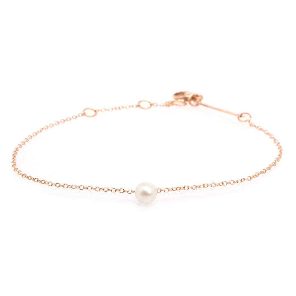 14k single white pearl dangle bracelet