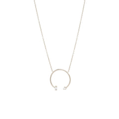 14k medium open circle necklace with baguette and prong diamonds