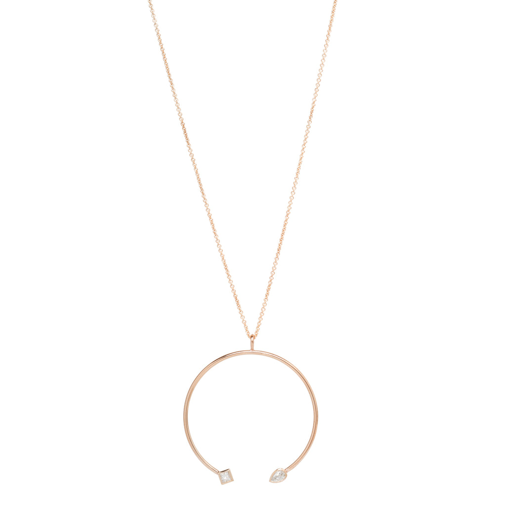 14k long open circle necklace with pear and princess diamonds