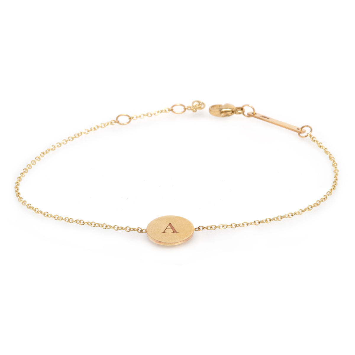 14k small disc bracelet with single initial engraved