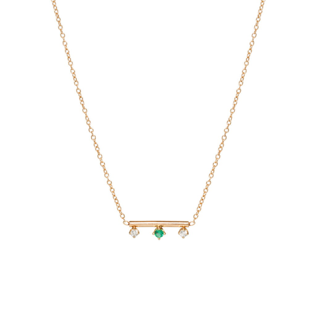 14k gold round bar necklace with prong set mixed diamonds and emerald on the bottom
