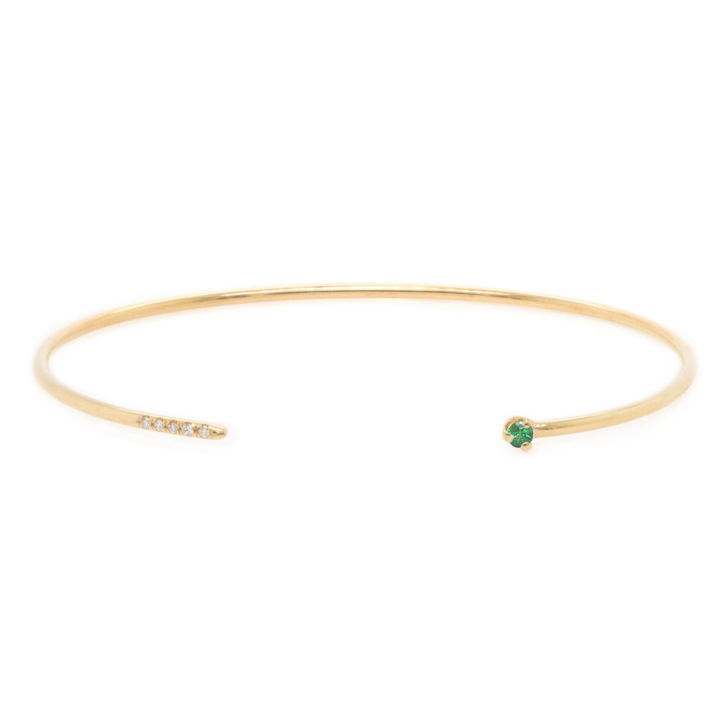 14k gold thin round cuff with 5 pave white diamonds and emerald