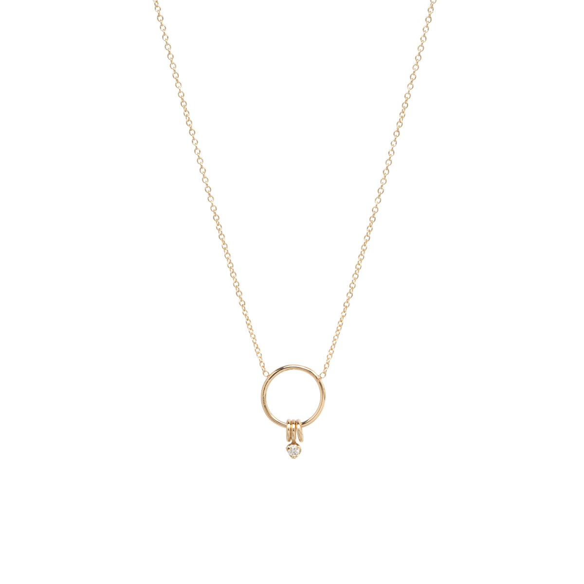 14k small circle necklace with 3 rings and single prong diamond