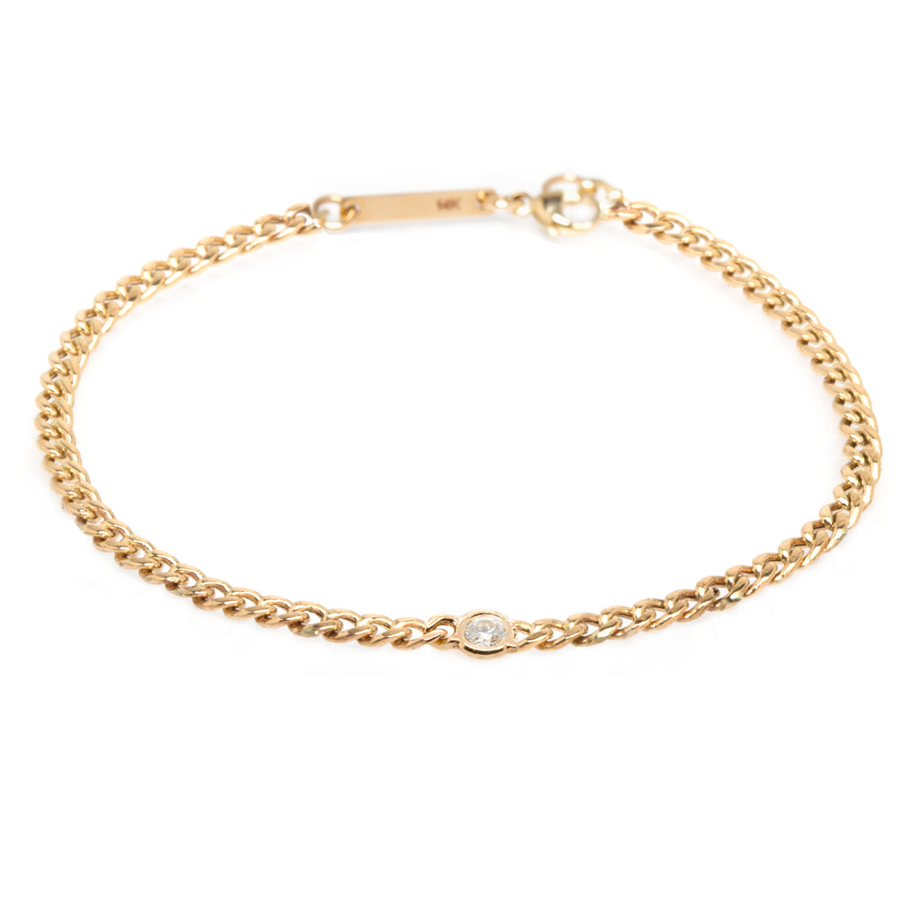 14k small curb chain bracelet with single floating diamond