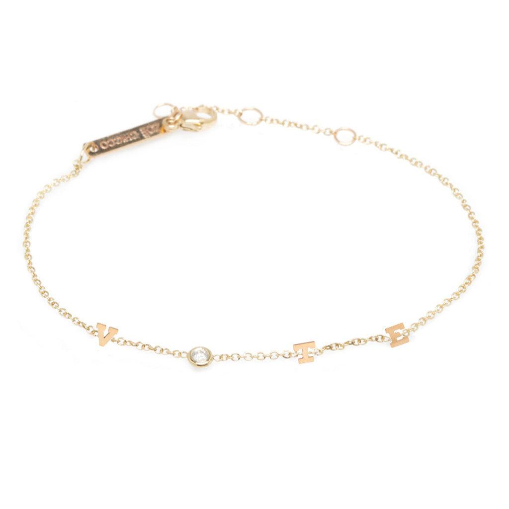 14k itty bitty & diamond spread out VOTE bracelet