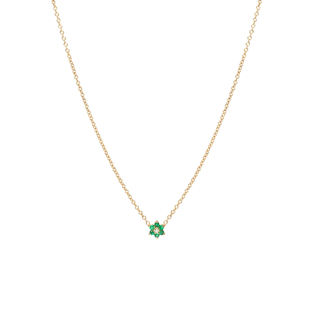 14k gold tiny prong set flower necklace with emerald petals and a diamond center