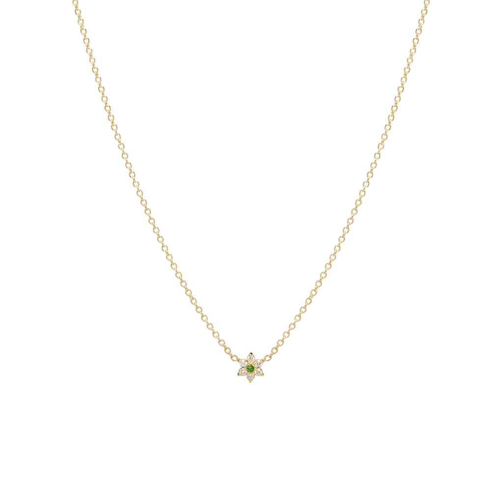 14k gold tiny prong set flower necklace with diamond petals and an emerald center