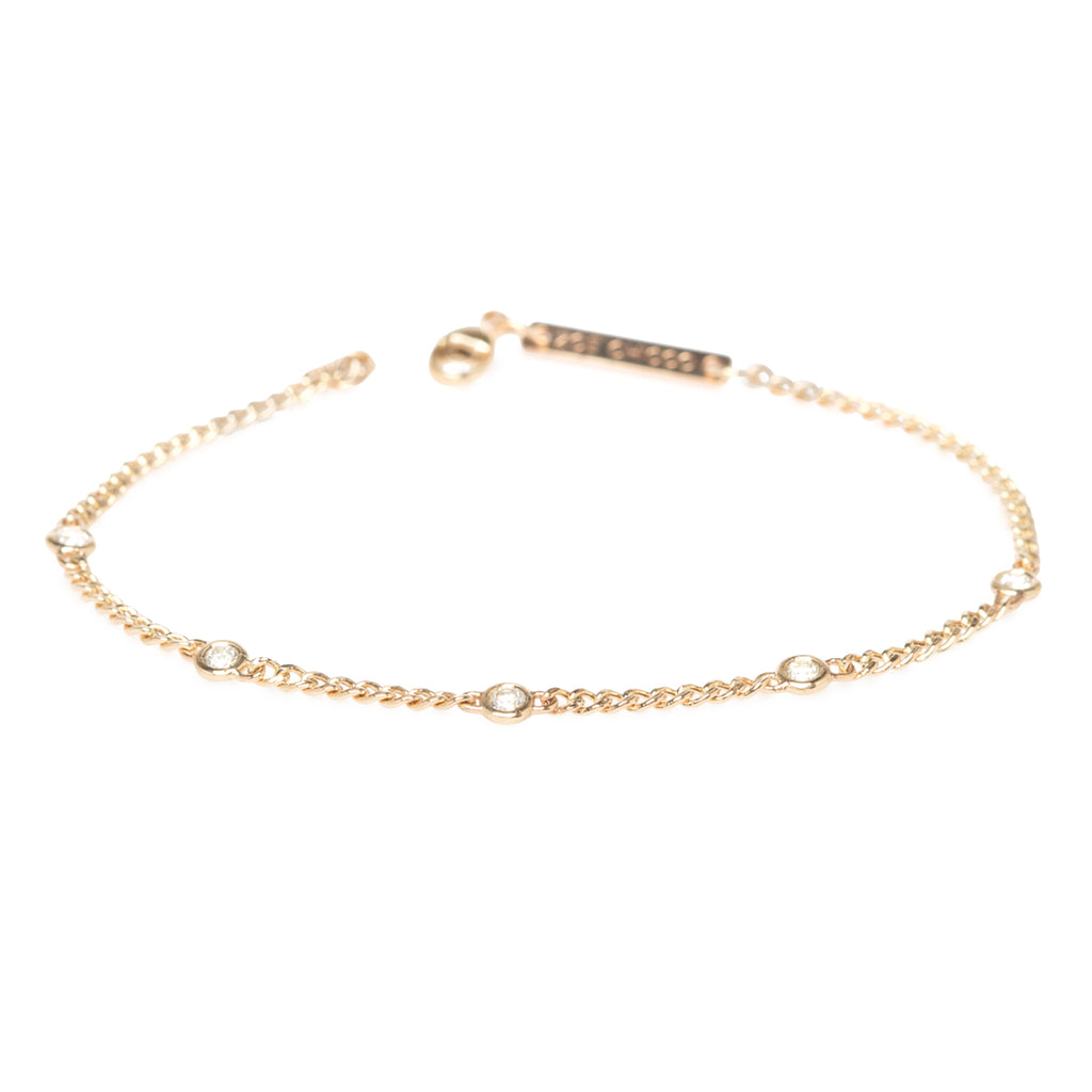14k extra small curb chain bracelet with 5 floating diamonds