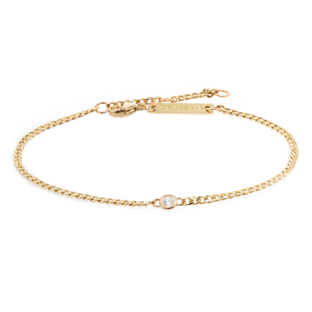 14k extra small curb chain bracelet with single floating diamond