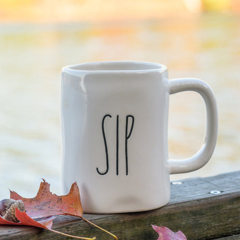 White coffee mug with the word SIP in black writing