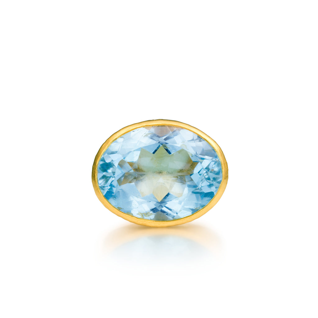 ARA Oval Blue Topaz Ring in 24k Yellow Gold
