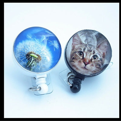 Kitty badge reel and dandelion sky badge reel