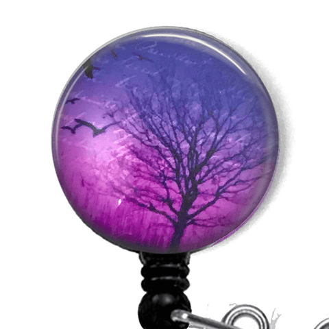Black Tree Silhouette against Purple Sky Badge Reel