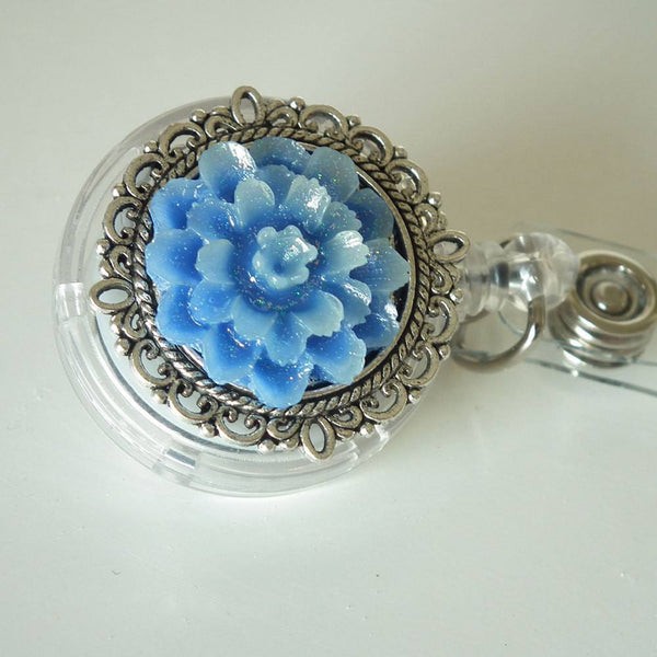 ID Badge Reel: Glimmer Blue Rose Cabochon on Silver Filigree Round - Alligator Clip - Plum Beadacious
