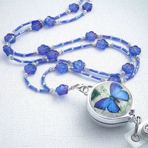 Beaded Lanyard/Badge Reel - Czech Glass Blue Flowers, Blue Butterfly on Photo Glass Badge Reel - Plum Beadacious