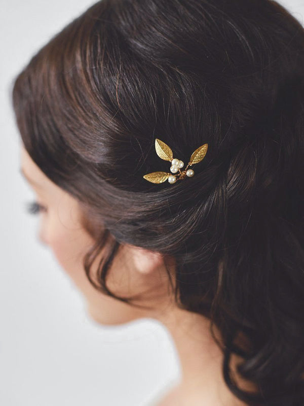 Bride wearing Adele Hairpin, Handspun golden hairpins with delicate gold leaflets and blossoming ivory pearls.
