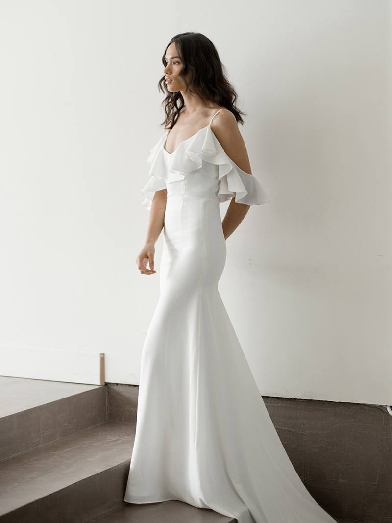 Boho wedding dress made of crepe de chine, luxurious crepe hugs through the hips for a decidely sexy silhouette.
