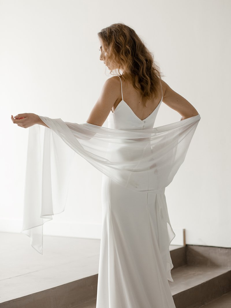 Modern Bride in wedding gown wrapped in Simple Wilk Wedding Wrap made of luxurious silk chiffon