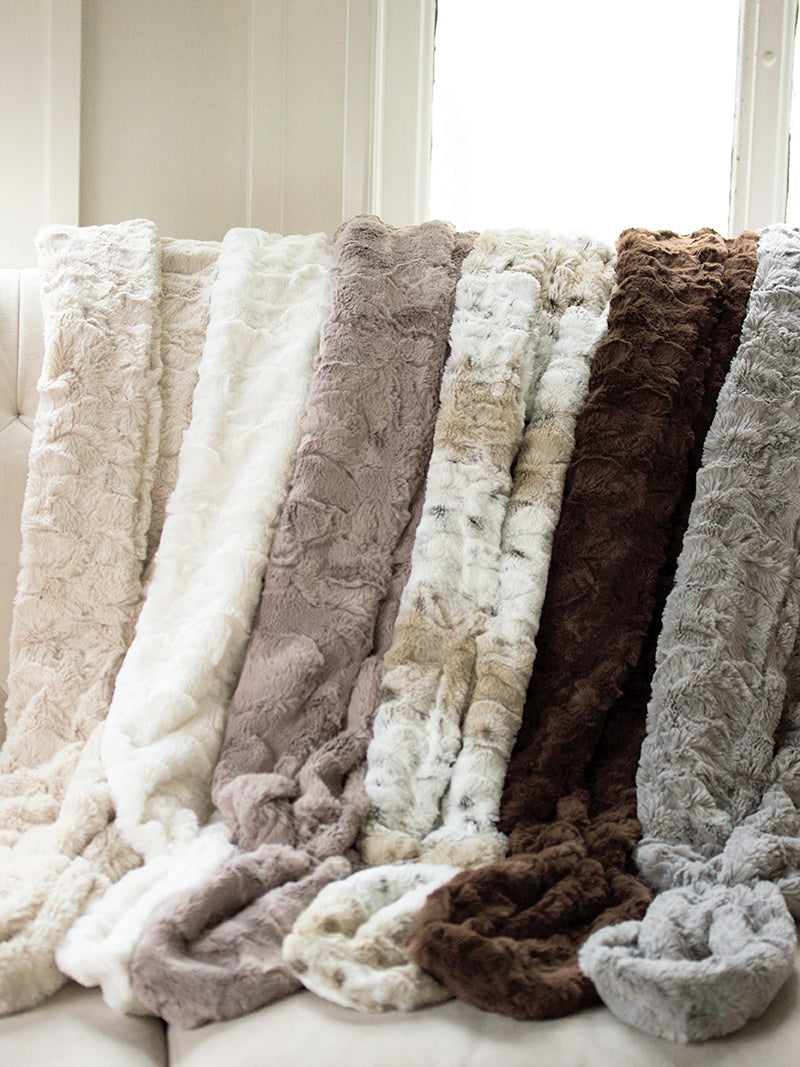 Davie and Chiyo faux fur shawl collection, colors from left to right: Honey, Ivory, Vintage Taupe, Snow Leopard, Hazelnut, and Silver Birch