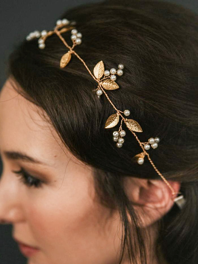 Bride wearing Adelia Hair Vine, Adelia Hair Vine, made with gilded leaves and opalescent pearl buds