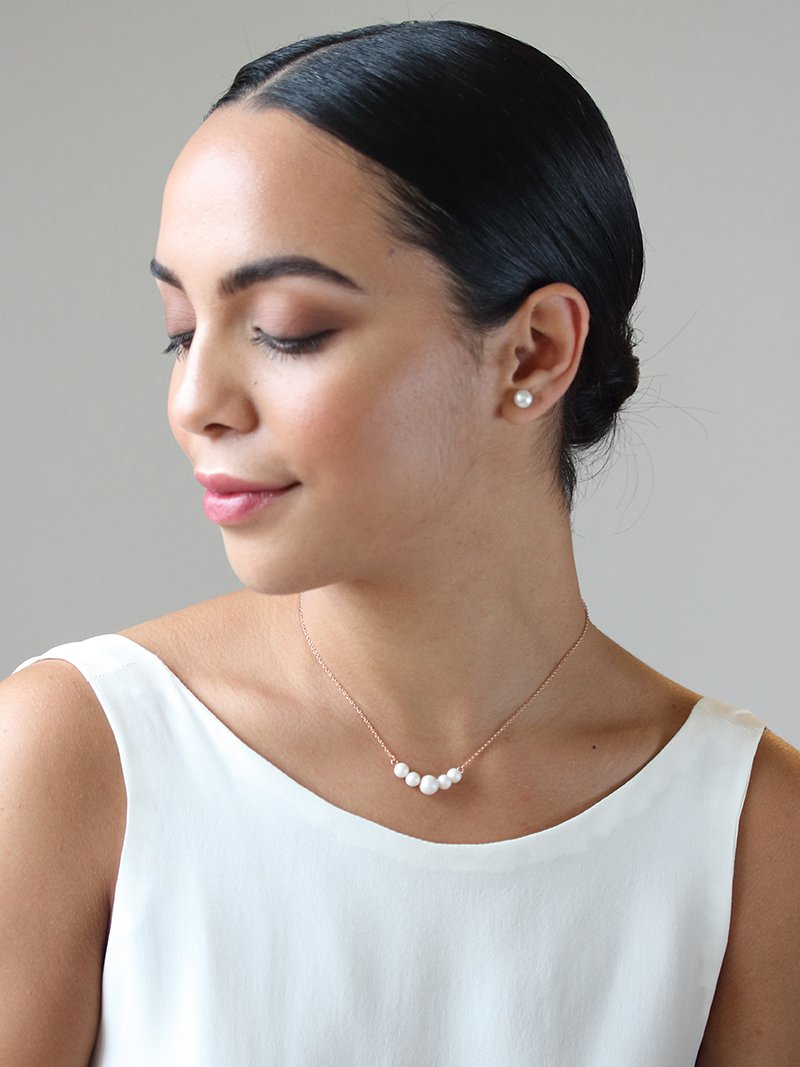 Bride wearing Adara Necklace, Iridescent ivory Swarovski Pearl Necklace, made by Davie & Chiyo