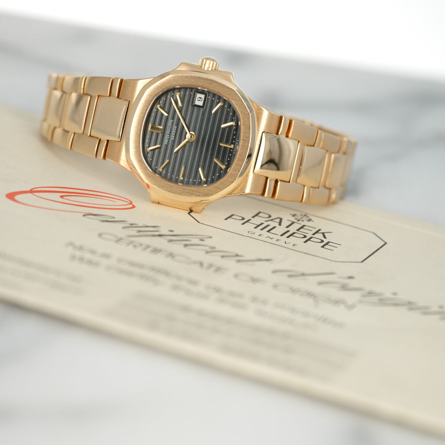 Patek Philippe Yellow Gold Nautilus Watch Ref. 4700 with Original Warranty Paper