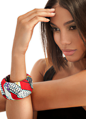 Red, white, blue fabric bangle. Worn by a brunette model.