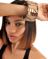 Multiple brown bangle. Fabric. Worn by a brunette model.