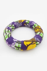 Large round bangle, yello, purple, green fabric wrapped around.