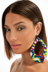 Multicolor large loop earrings. Blue, pink, green fabric. Worn by a brunette model.
