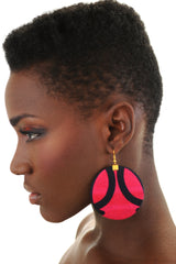 Pink and blue earrings. Round shape. Gold hook. Worn by a black model.