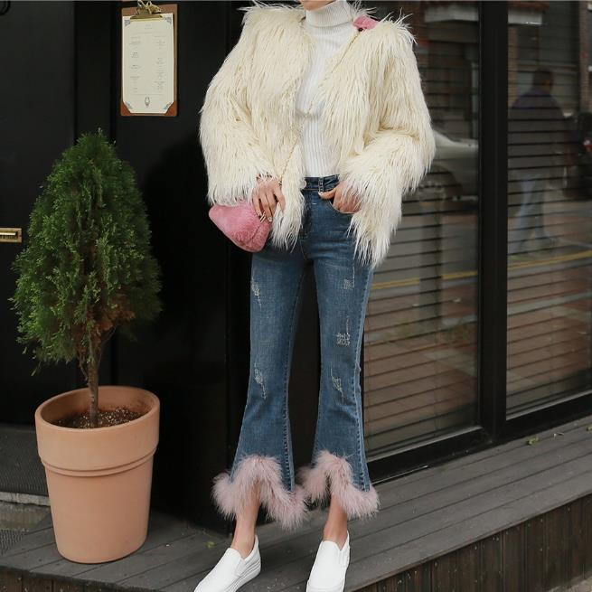 High Waist Skinny Ripped & Flare jeans with pink Feather trim.