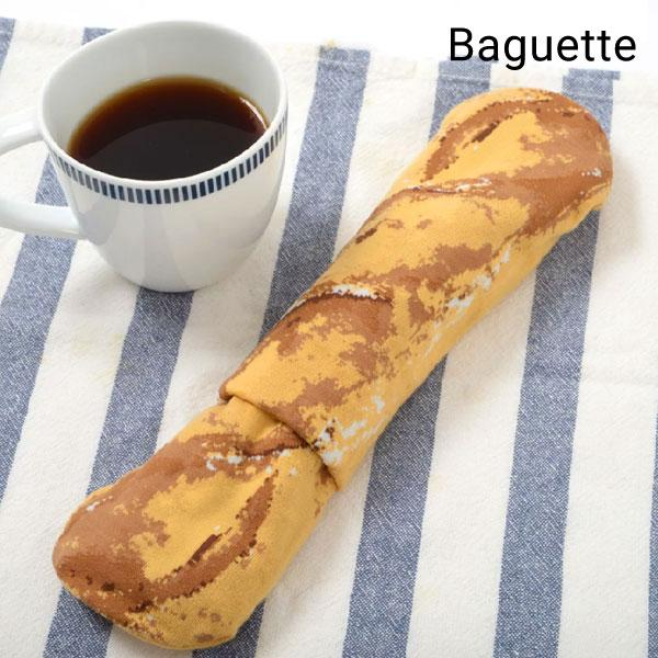 Unusual Baguette shaped novelty socks on a tablecloth with a cup of coffee