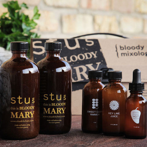 Stu's Kitchen Bloody Mary Mixology Kit lifestyle shot with bottles and packaging