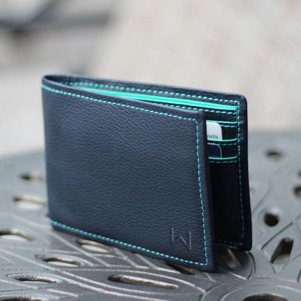 Walli The Smart Wallet blue / teal version on a steel surface outdoors