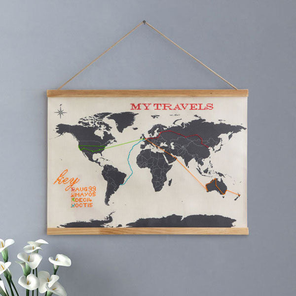 Embroidered Cross Stitch Map hanging on a grey wall - buy at The Fowndry