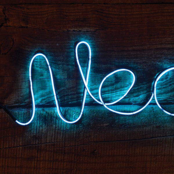 DIY Neon Light Kit blue version on a wooden background