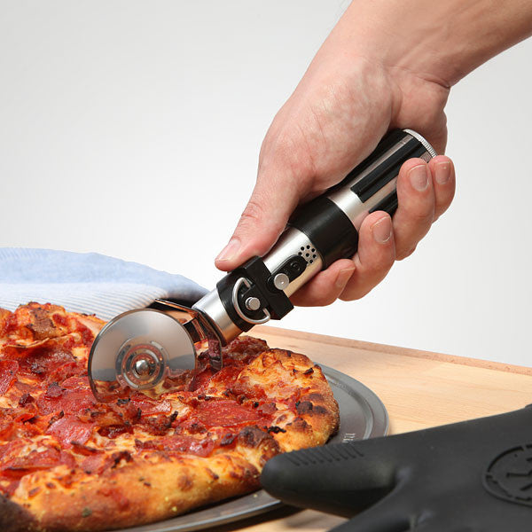 Star Wars Lightsaber Pizza Cutter cutting a pepperoni pizza