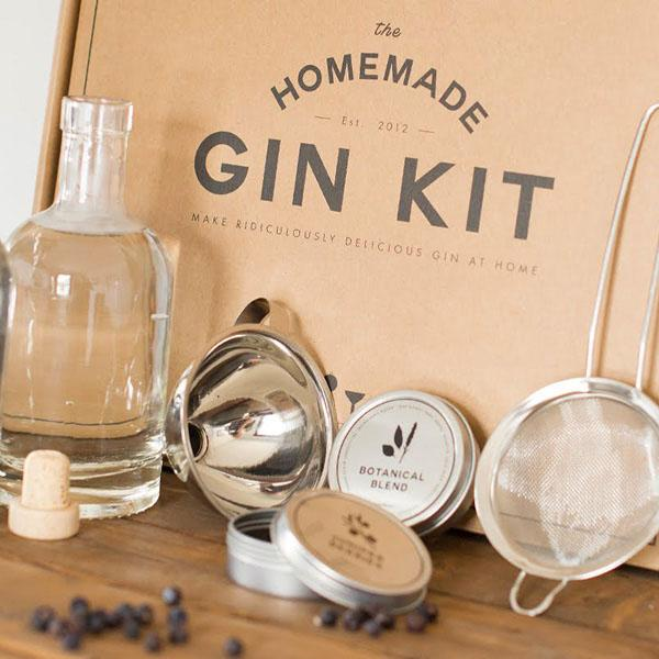 Close up of The Homemade Gin Kit and its contents propped against a wall in a kitchen