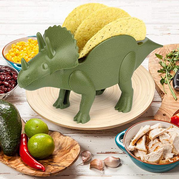 TriceraTACO dinosaur taco holder on a work surface with ingredients